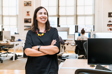 smiling-businesswoman-in-office_4460x4460.jpg