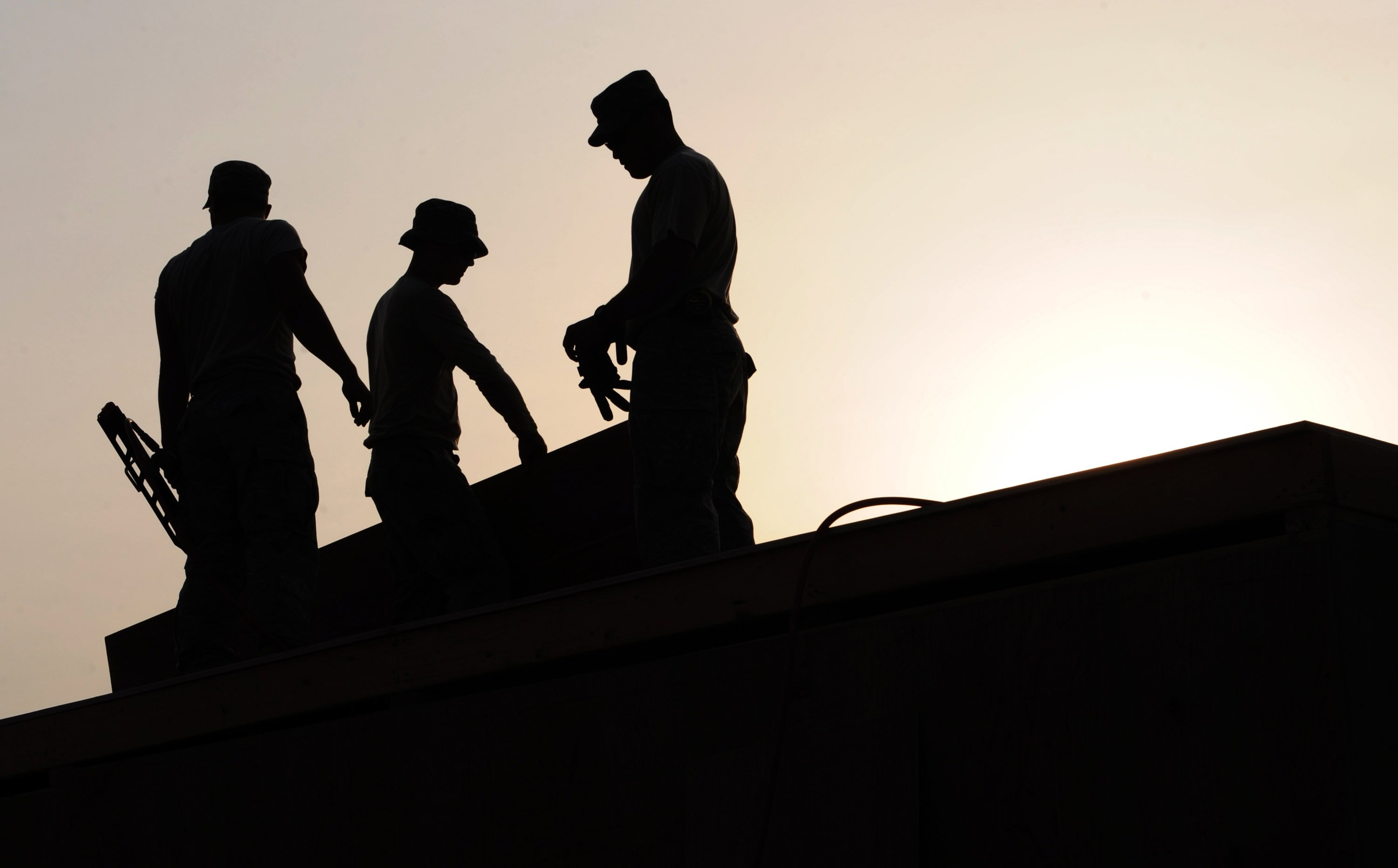 workers-construction-site-hardhats-38293.jpeg